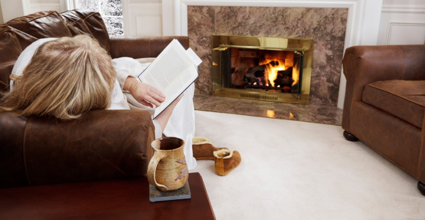woman-reading-by-fire-in-condo